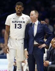 Xavier Musketeers forward Naji Marshall (13) talks with head coach Travis Steele on the sideline in the first half of the NCAA basketball game between the Xavier Musketeers and the Oakland Golden Grizzlies at the Cintas Center in Cincinnati on Saturday, Dec. 1, 2018. Xavier led 41-36 at halftime.