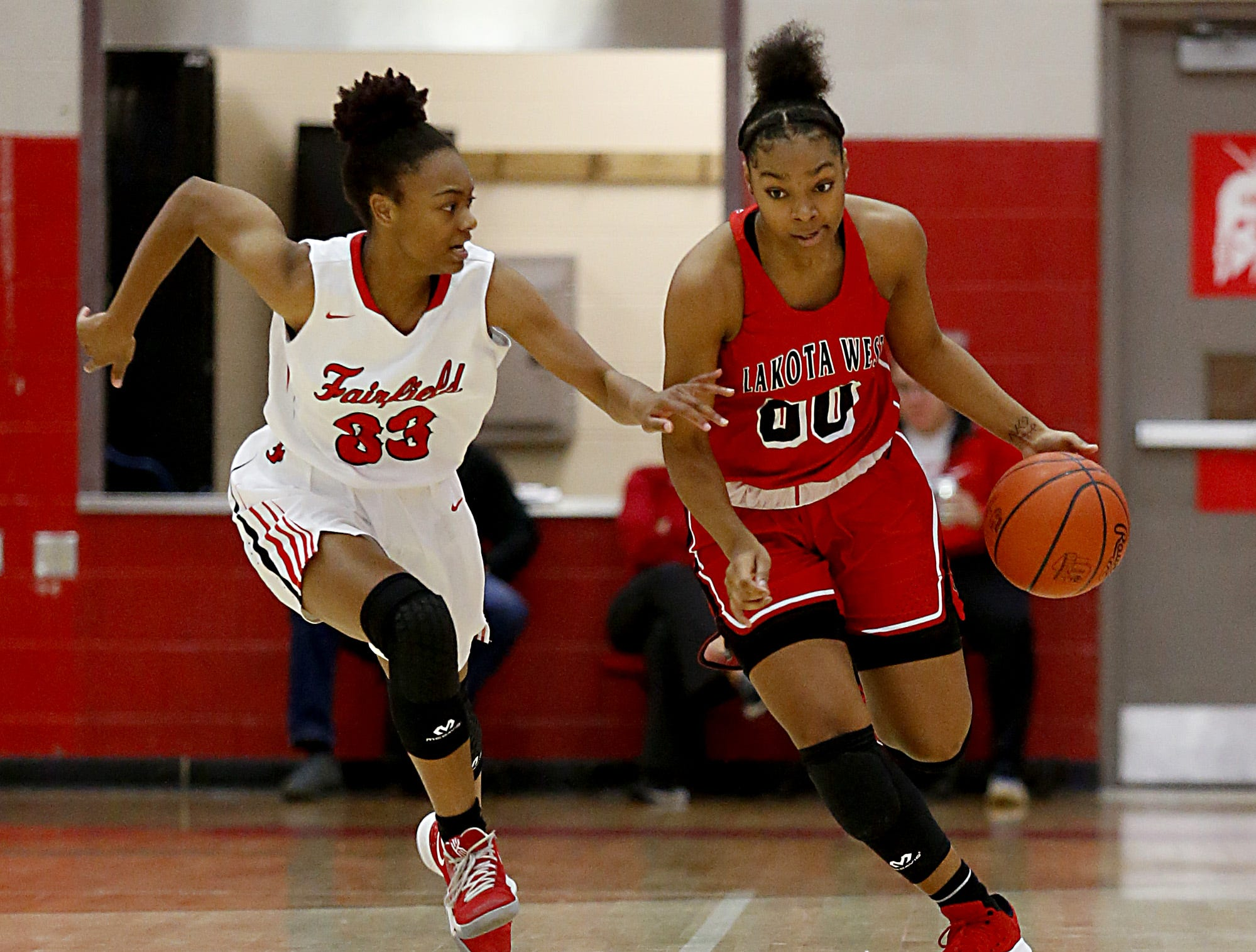 Lakota West guard Jaydis Gales is covered by Fairfield guard Kelis Jones during their game at Fairfield Saturday, Dec. 1, 2018.