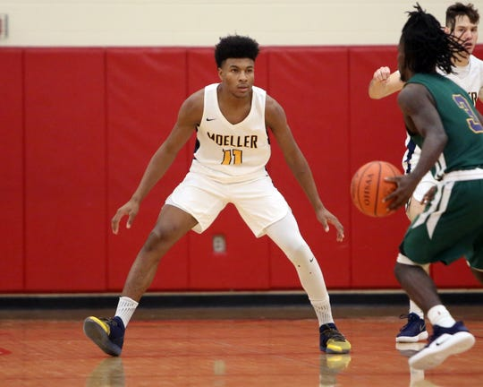 Moeller guard Miles McBride guards Bryan Station's Elijah Chenault the Ohio Valley Hoops Classic at Hillsboro High School Dec. 1.