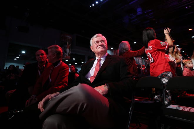 Cincinnati Reds CEO Bob Castellini smiles as former and current players are introduced during Redsfest.