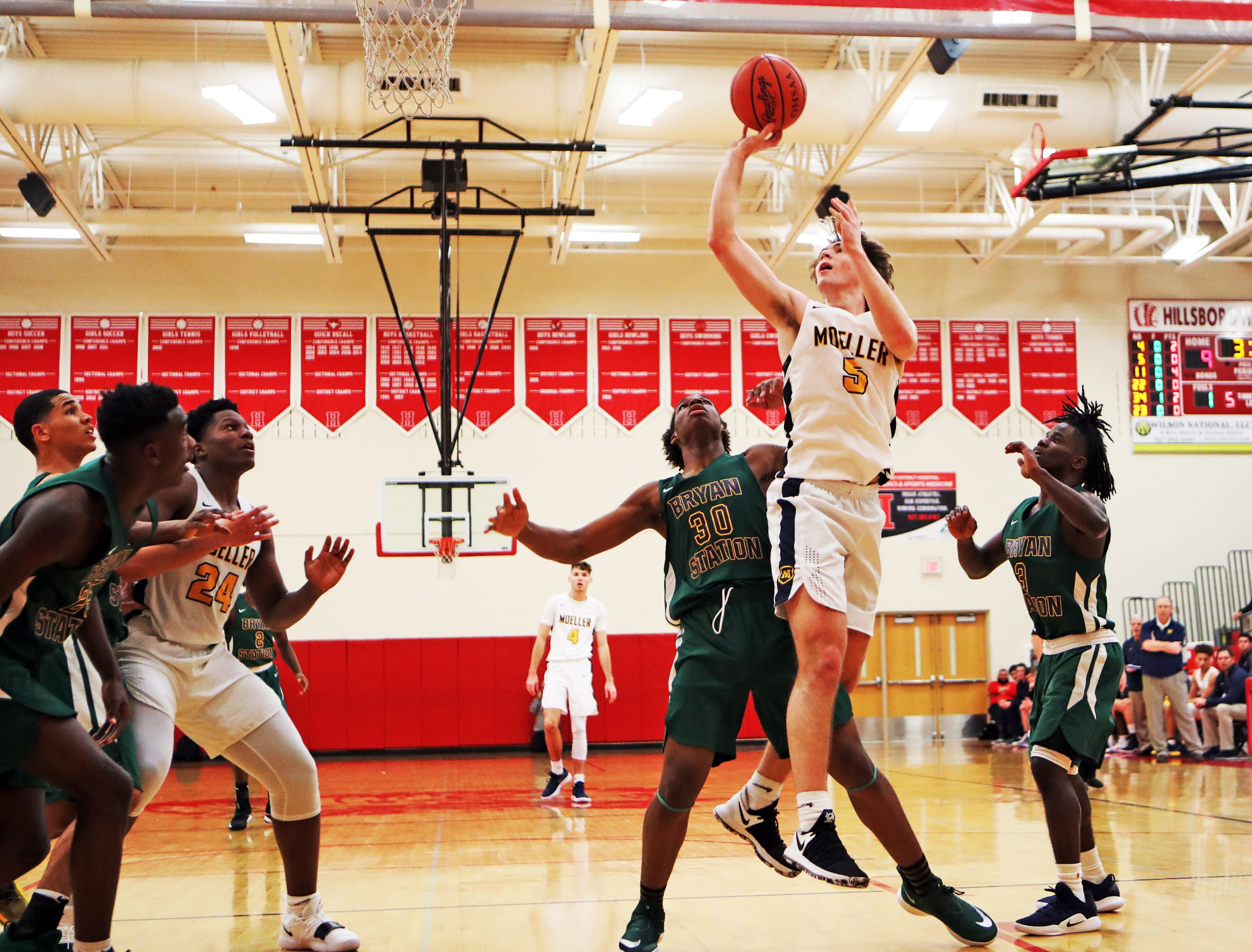 Moeller guard Alec Pfriem drives and scores at the Ohio Valley Hoops Classic at Hillsboro High School Dec. 1.