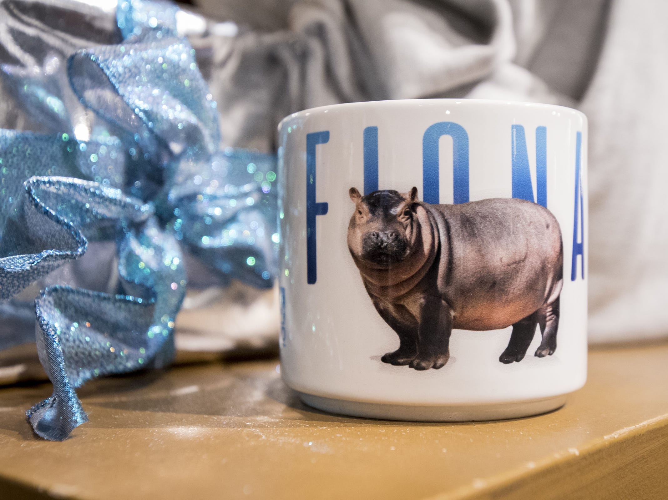 Special Fiona-themed items are for sale during the Cincinnati Zoo's Fiona 1k walk in honor of the beloved hippo's 1,000-pound milestone Saturday, December 1, 2018 in Cincinnati, Ohio.