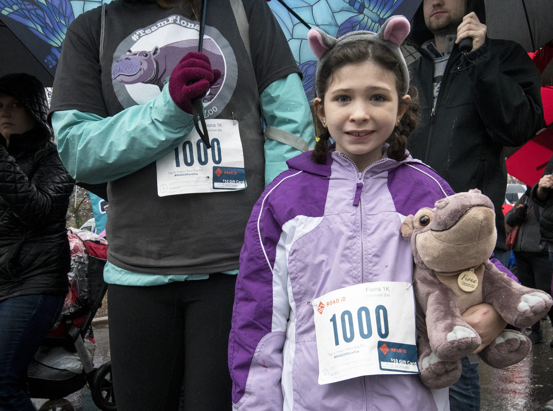 Bree Wieger of Lexington has hippo ears to match her stuffed Fiona toy at the Cincinnati Zoo's Fiona 1k walk in honor of the beloved hippo's 1,000-pound milestone Saturday, December 1, 2018 in Cincinnati, Ohio.