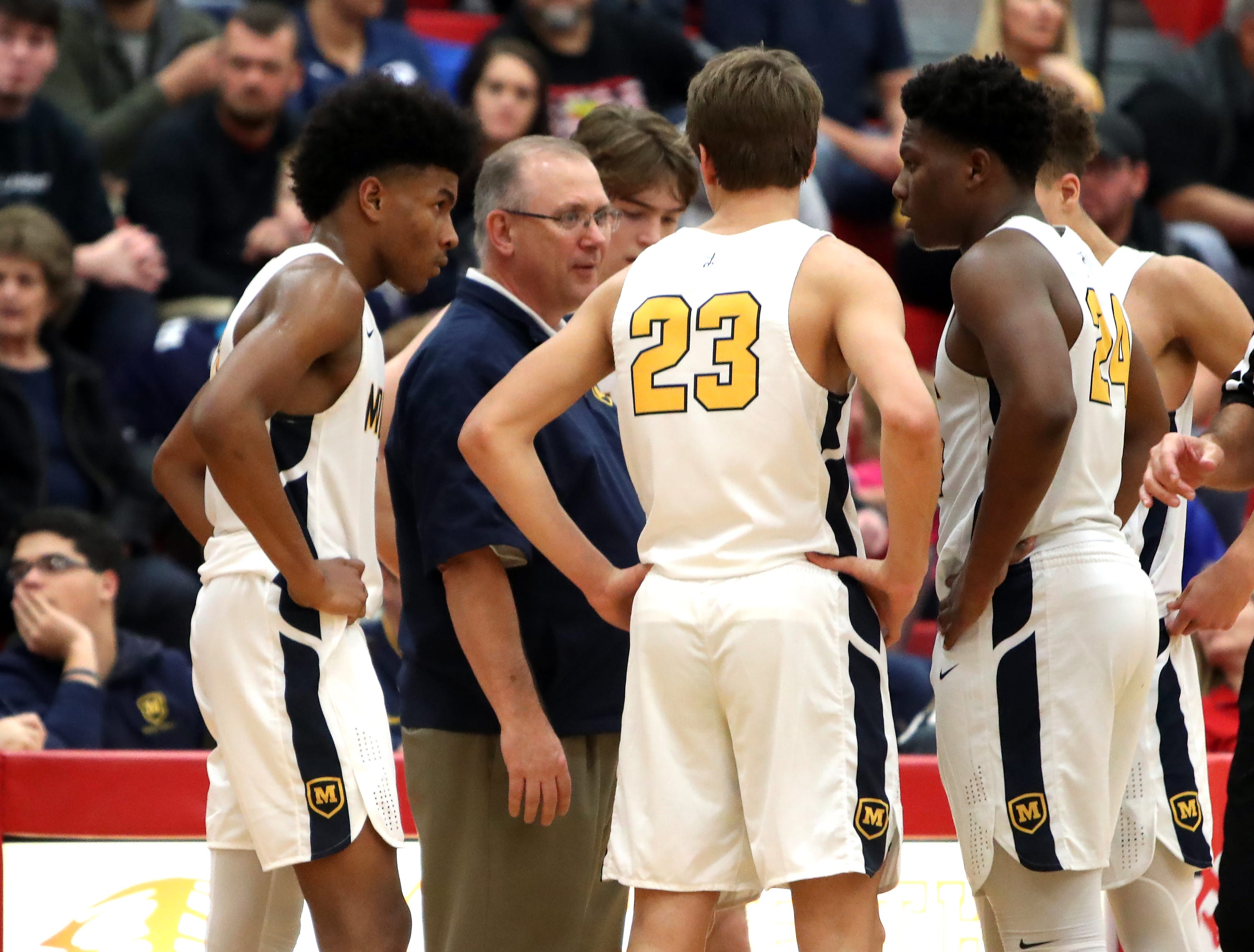 Moeller head coach Carl Kremer talks to his team during a time out at the Ohio Valley Hoops Classic at Hillsboro High School. Moeller defeated Bryan Station 85-42.