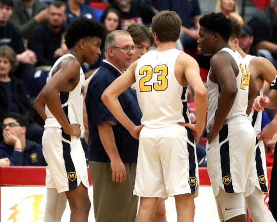 Moeller head coach Carl Kremer talks to his team during a time out at the Ohio Valley Hoops Classic at Hillsboro High School. Moeller defeated Bryan Station 85-42 Dec. 1, 2018.