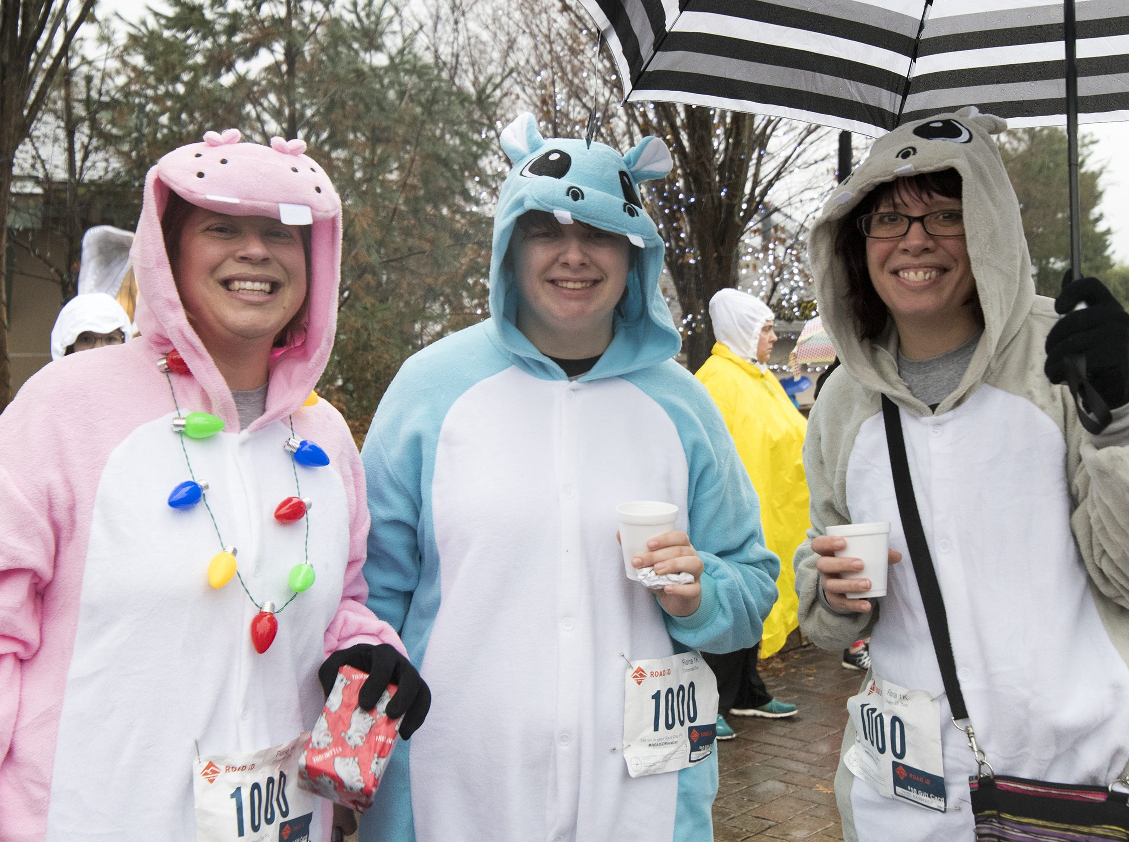 Andrea Thompson and Joe and Teagan Dumont get a lot of attention with their hippo costumes at the Cincinnati Zoo's Fiona 1k walk in honor of the beloved hippo's 1,000-pound milestone Saturday, December 1, 2018 in Cincinnati, Ohio.