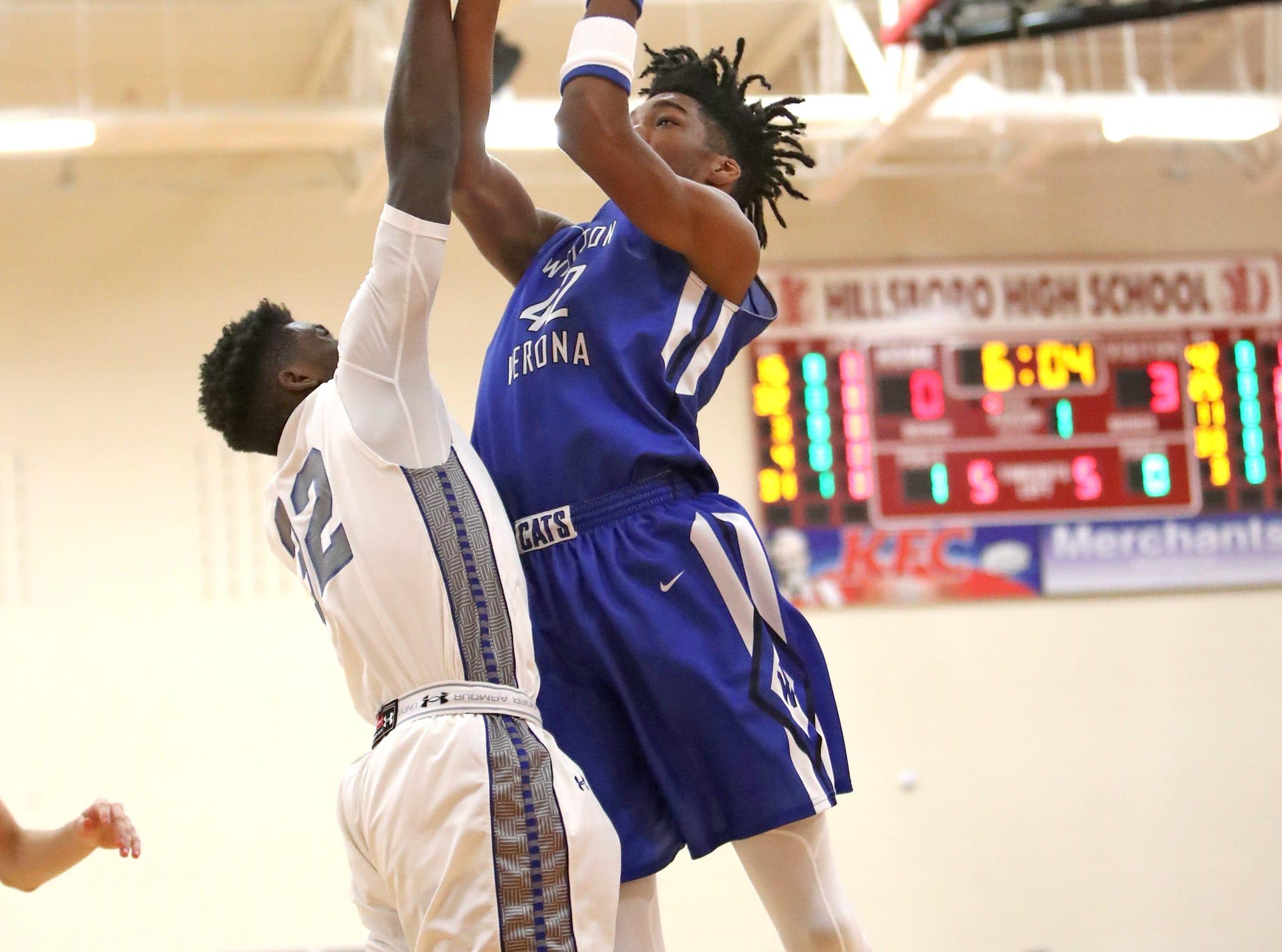 Walton Verona center Dieonte Miles attacks the basket at the Ohio Valley Hoops Classic at Hillsboro High School. Walton Verona defeated Xenia 62-54.
