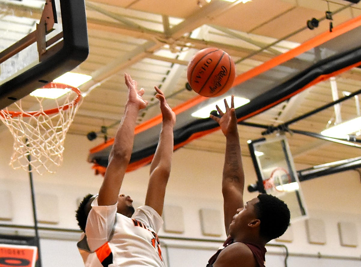 Dakarion Branch of Western Hills tosses up a layup over the Withrow defense of Mike Hill Jr. for a Mustangs basket, November 30, 2018.