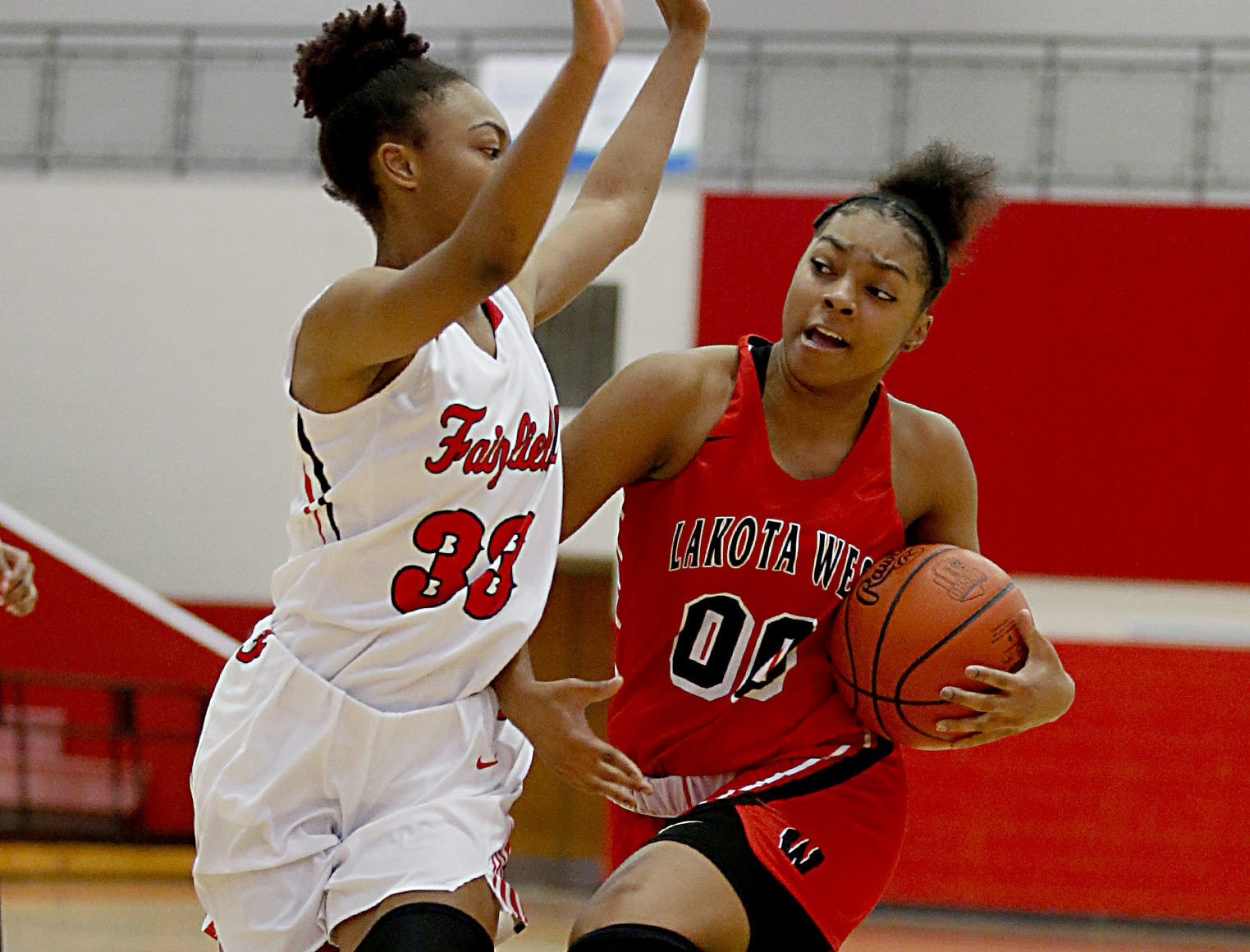 Lakota West guard Jaydis Gales breaks away from Fairfield guard Kelis Jones to score two during their game at Fairfield Saturday, Dec. 1, 2018.