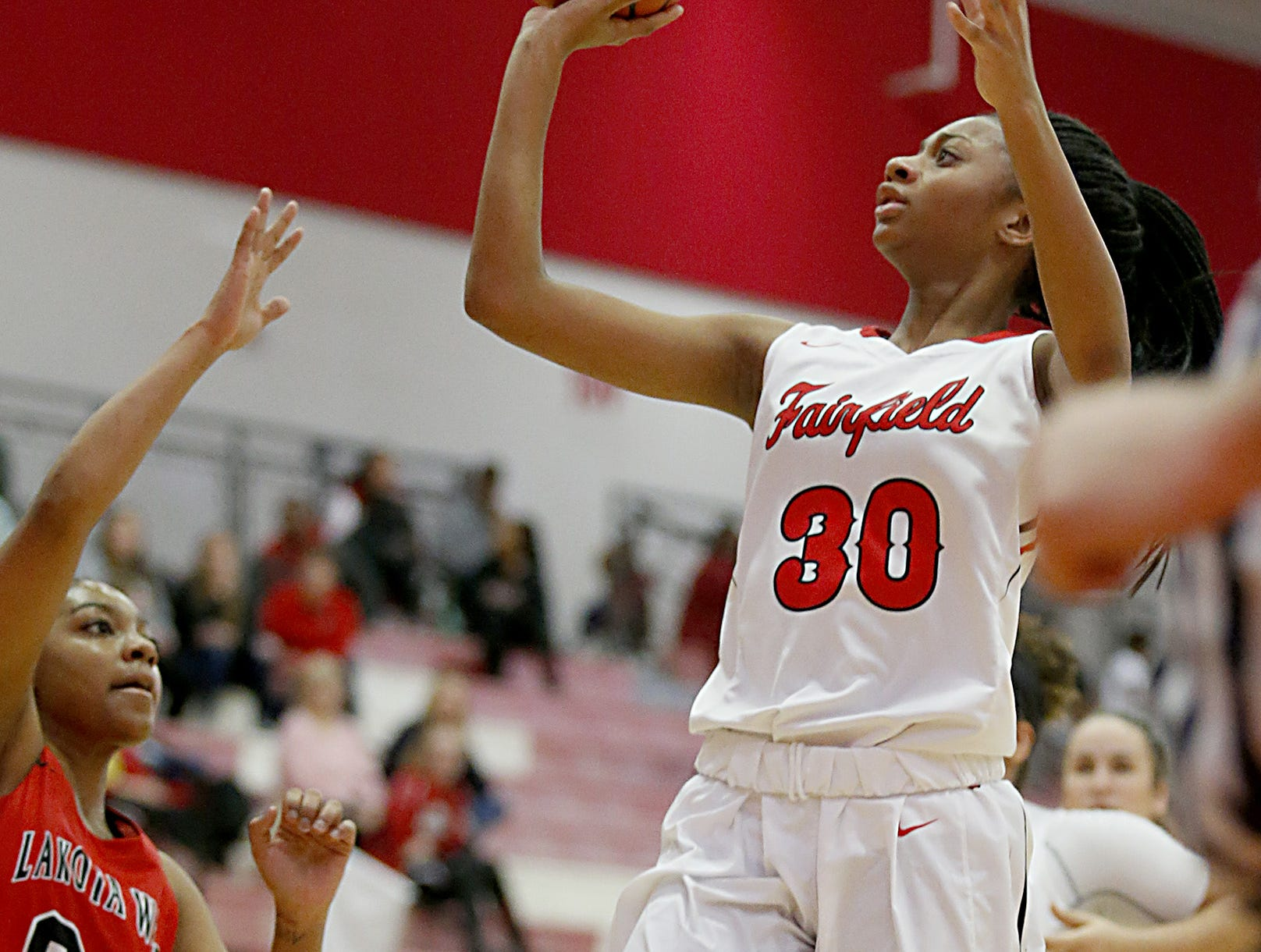 Fairfield forward Tori Williams shoots against Lakota West during their game at Fairfield Saturday, Dec. 1, 2018.