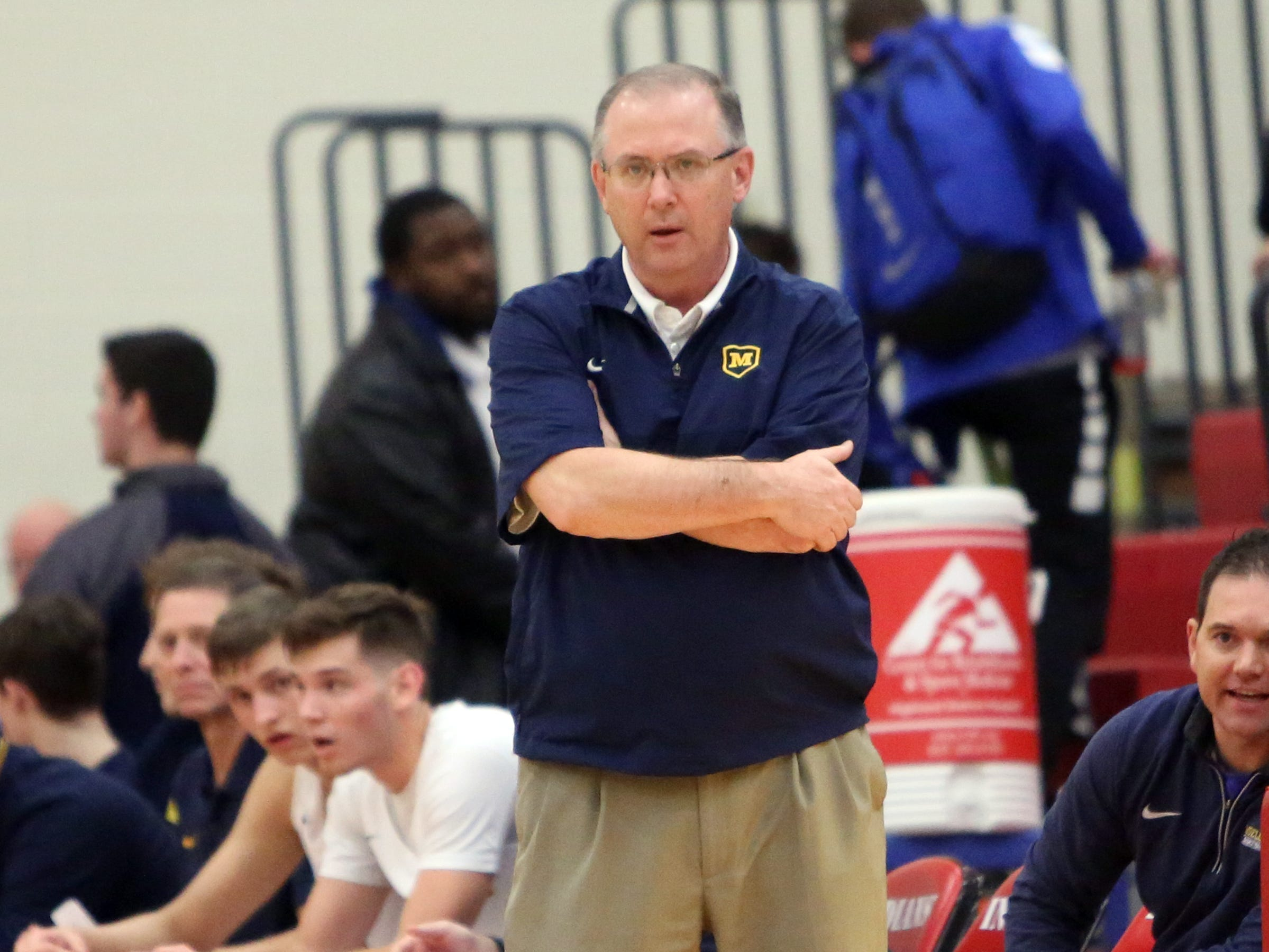 Moeller head coach Carl Kremer watches his team on offense at the Ohio Valley Hoops Classic at Hillsboro High School. Moeller defeated Bryan Station 85-42.