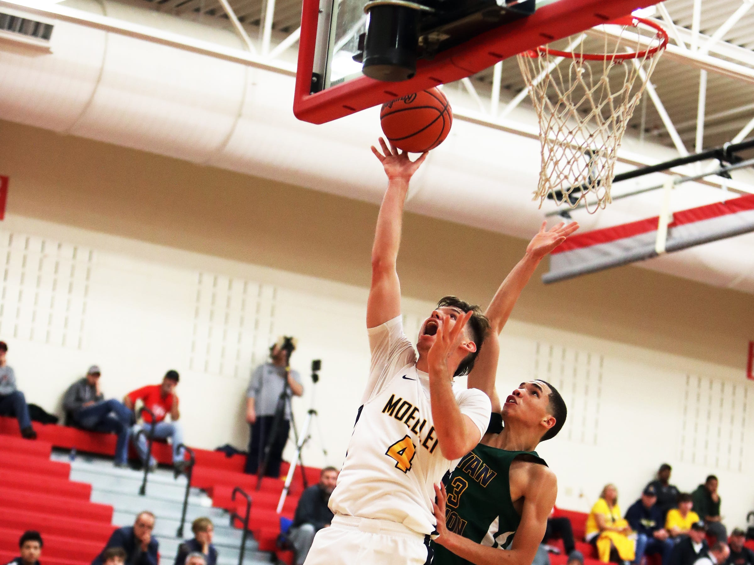 Moeller guard Michael Shipp scores on a lay up at the Ohio Valley Hoops Classic at Hillsboro High School. Moeller defeated Bryan Station 85-42.