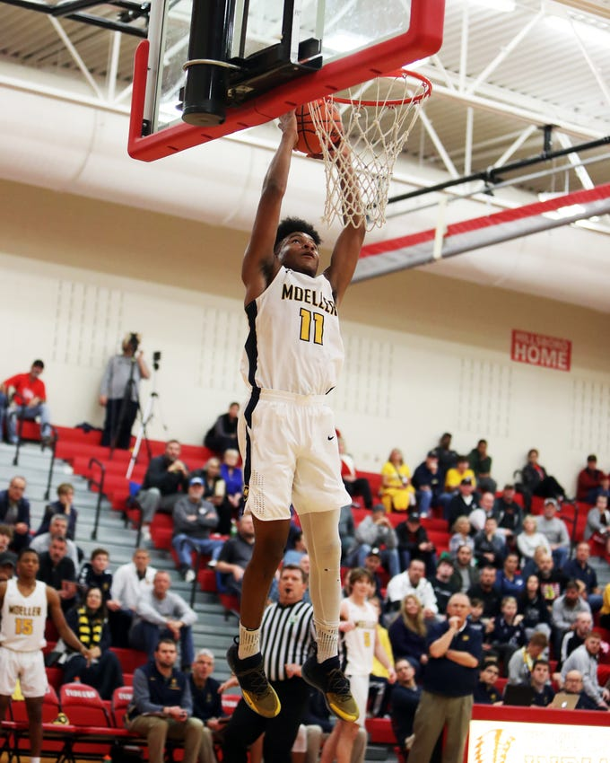 Moeller guard Miles McBride goes up for a dunk at the Ohio Valley Hoops Classic at Hillsboro High School. Moeller defeated Bryan Station 85-42.