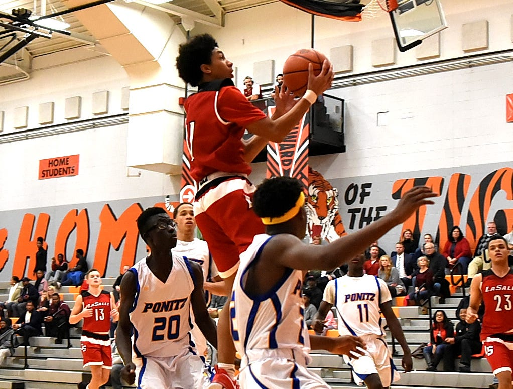 Jaylen Lemons (11)  takes the rock to the hoop for a La Salle basket in their 52-38 win over Ponitz, Nov. 30, 2018.