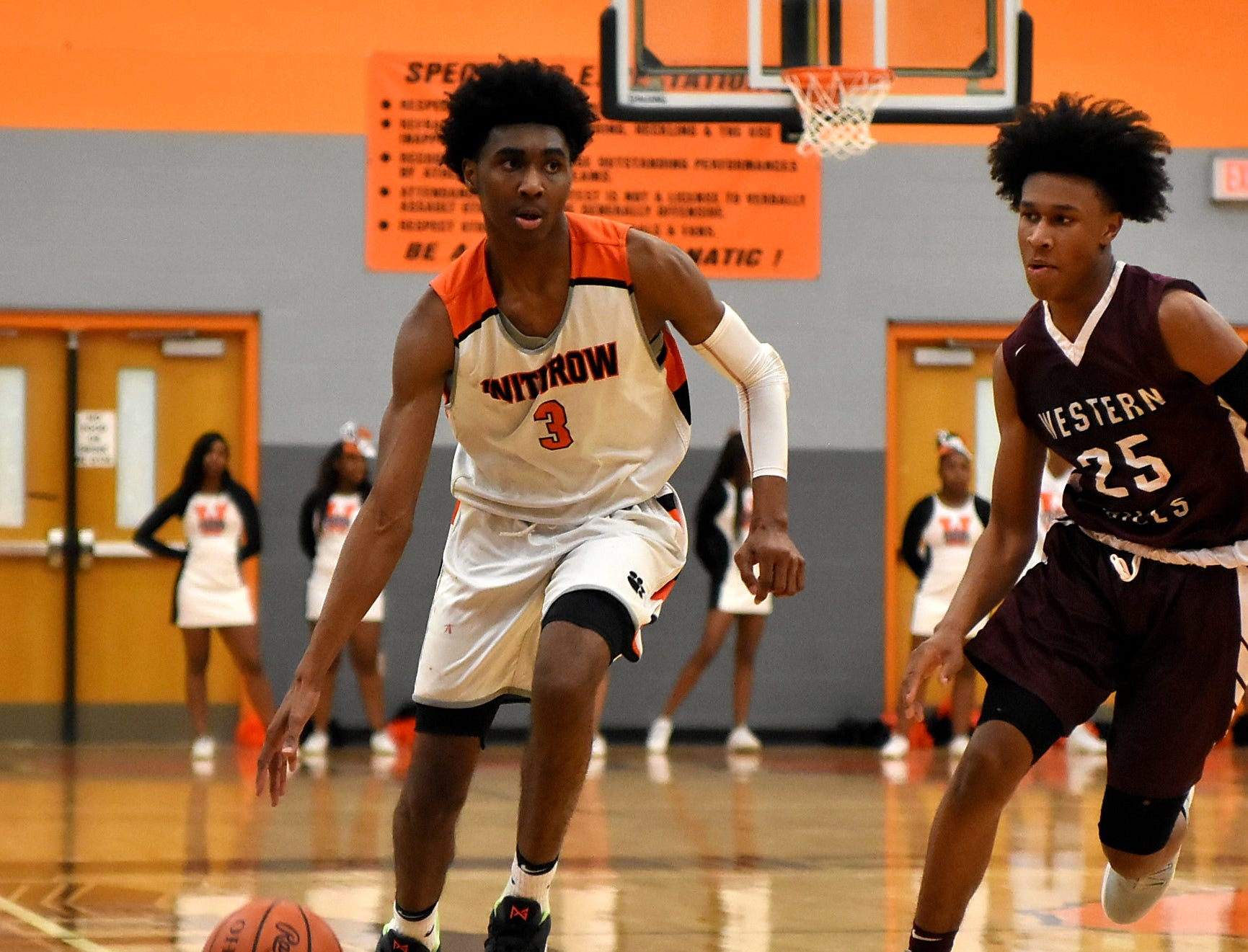 Mike Hill Jr. of Withrow dribbles past the time line breaking the Western Hills press defense, November 30, 2018.
