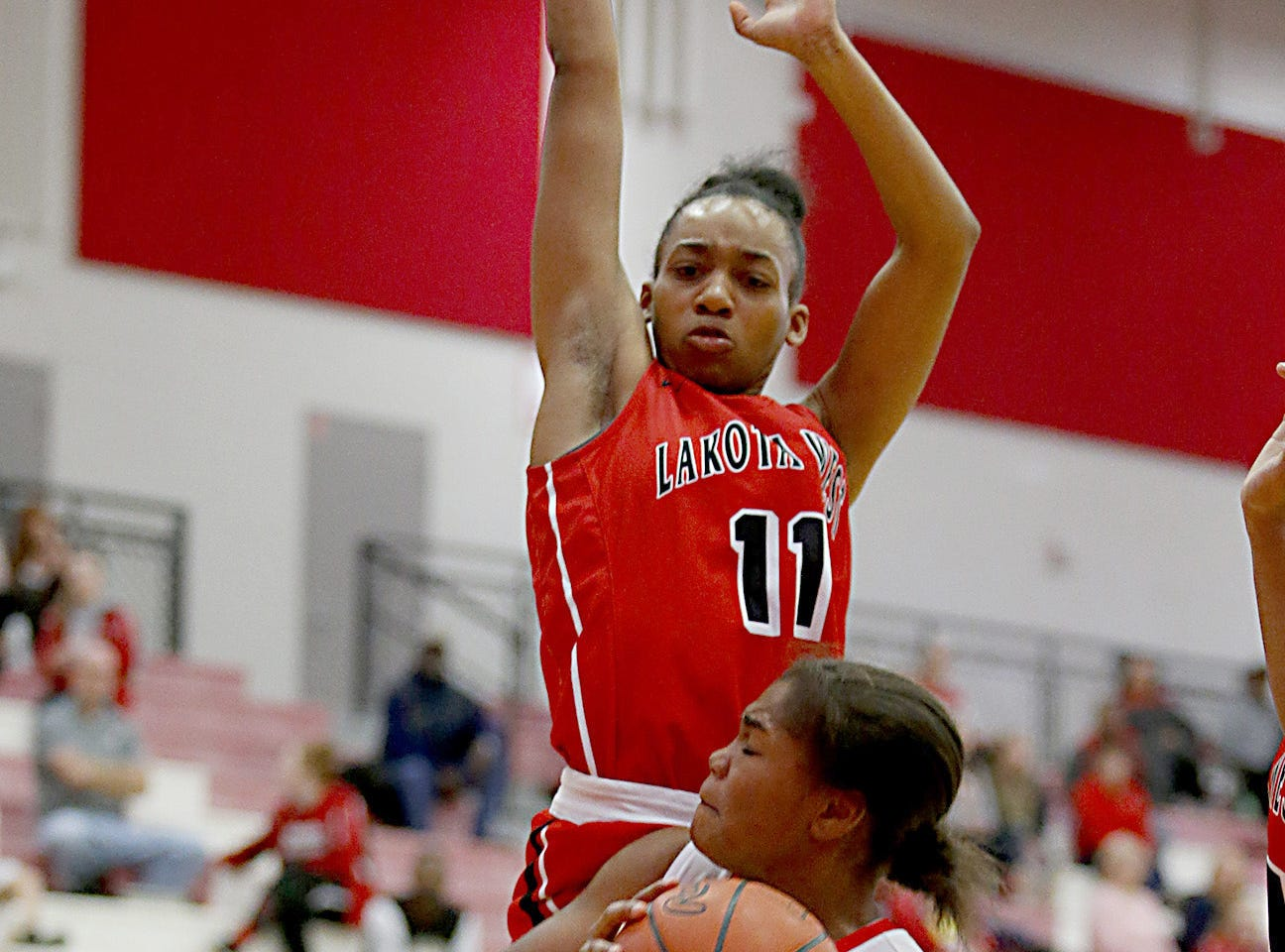 Fairfield guard Journee Hicks draws a foul from Lakota West's Dominique Camp during their game at Fairfield Saturday, Dec. 1, 2018.