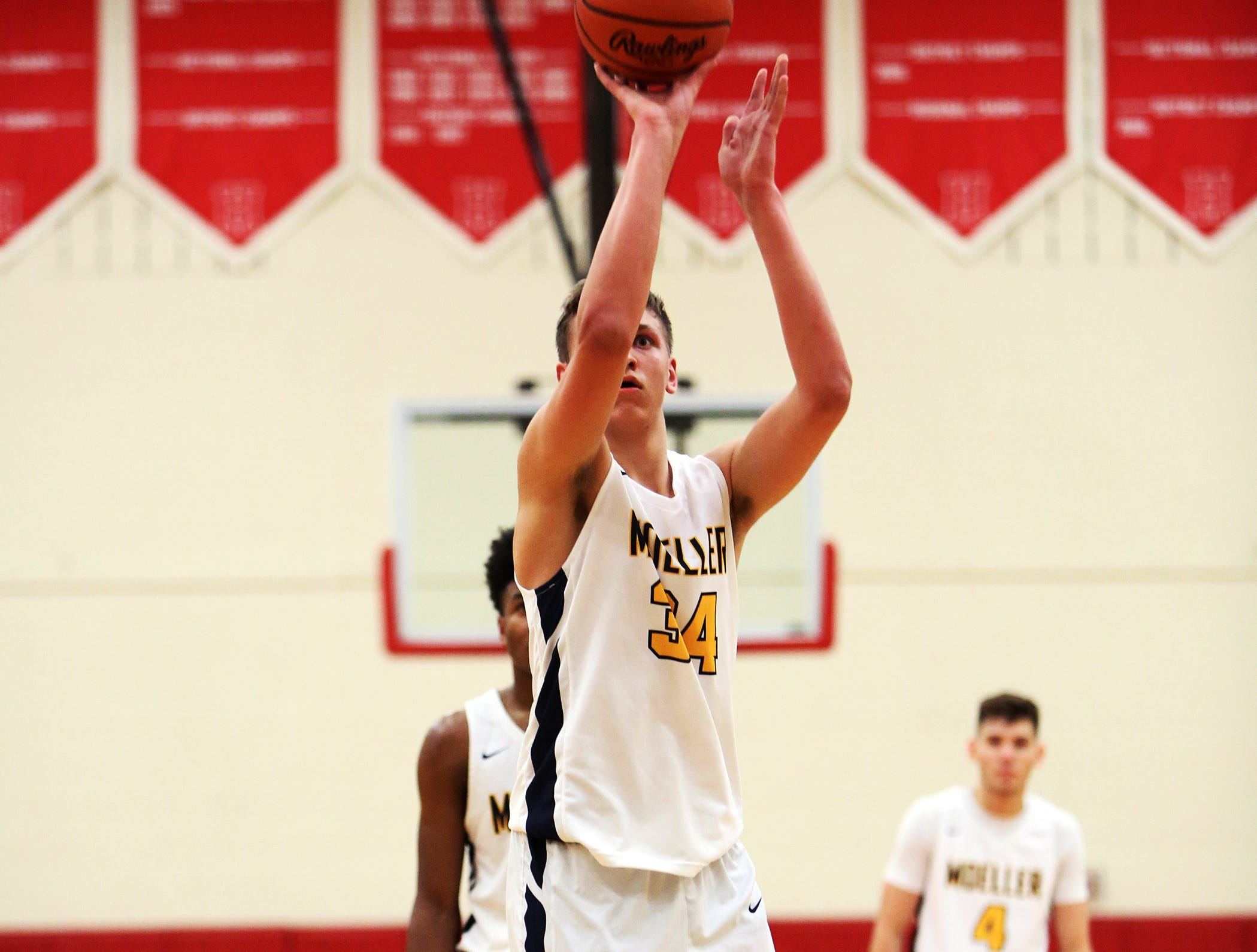 Moeller center Logan Holcomb attempts a free throw at the Ohio Valley Hoops Classic at Hillsboro High School. Moeller defeated Bryan Station 85-42.