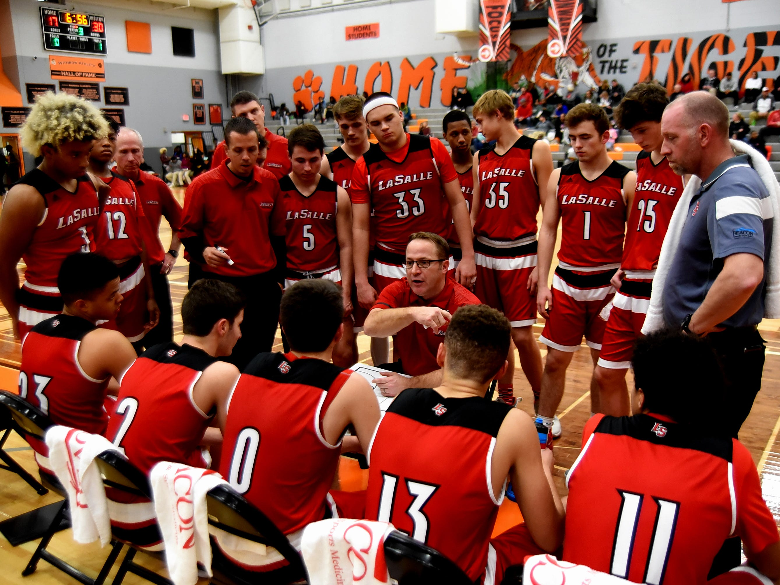 """The La Salle Lancers get a """"time out"""" regroup in the third quarter of their game against Ponitz, Nov. 30, 2018."""
