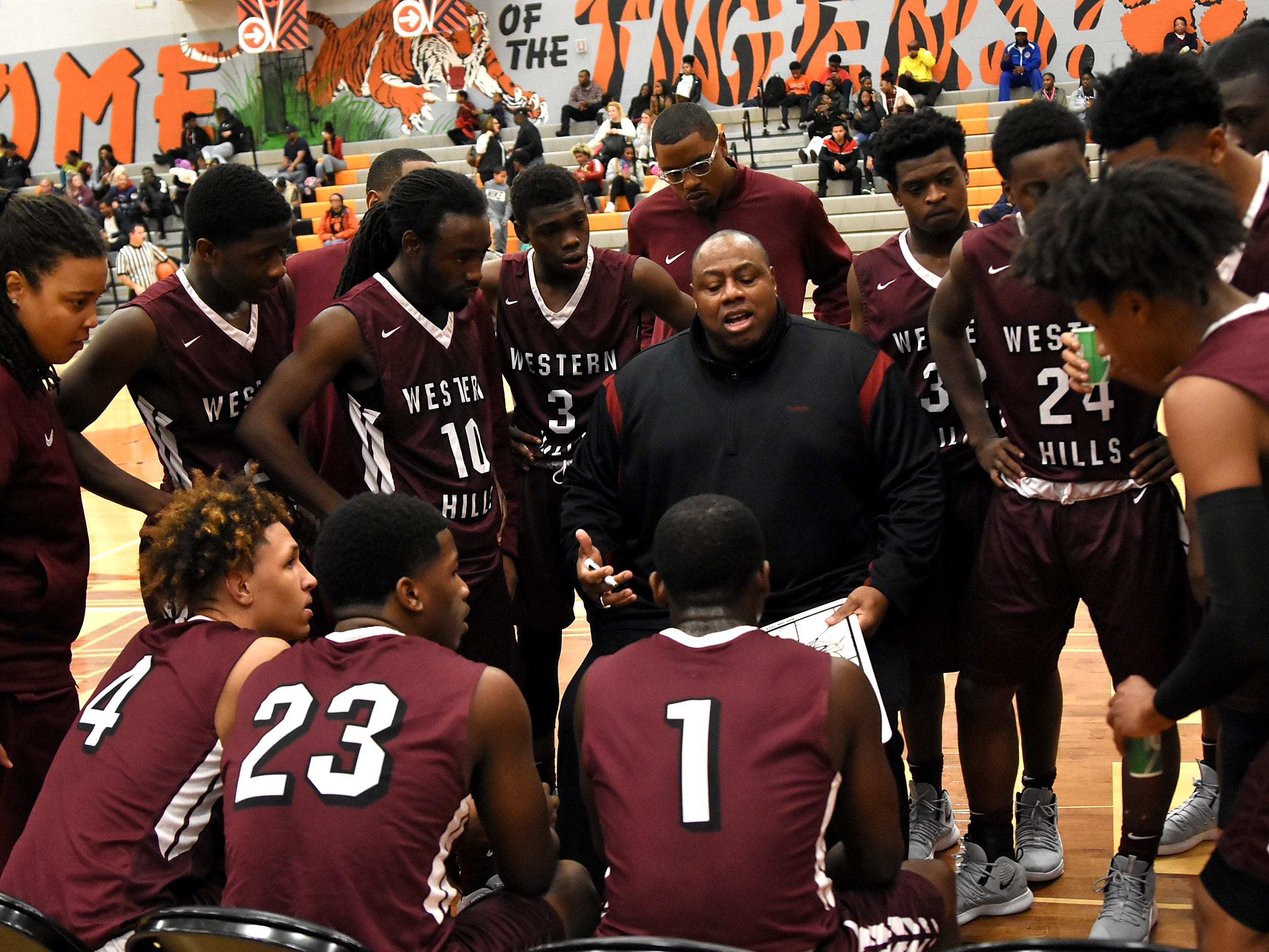 Head Coach Mark Mitchell of Western Hills uses a timeout to help the Mustangs set up their offense, November 30, 2018.