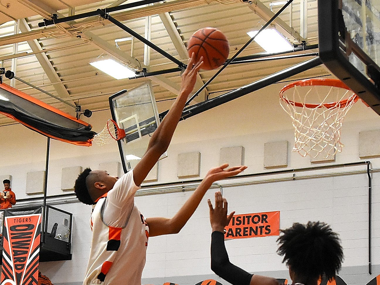 Abba Lawal of Withrow skies his way to the basket for the Tigers, November 30, 2018.