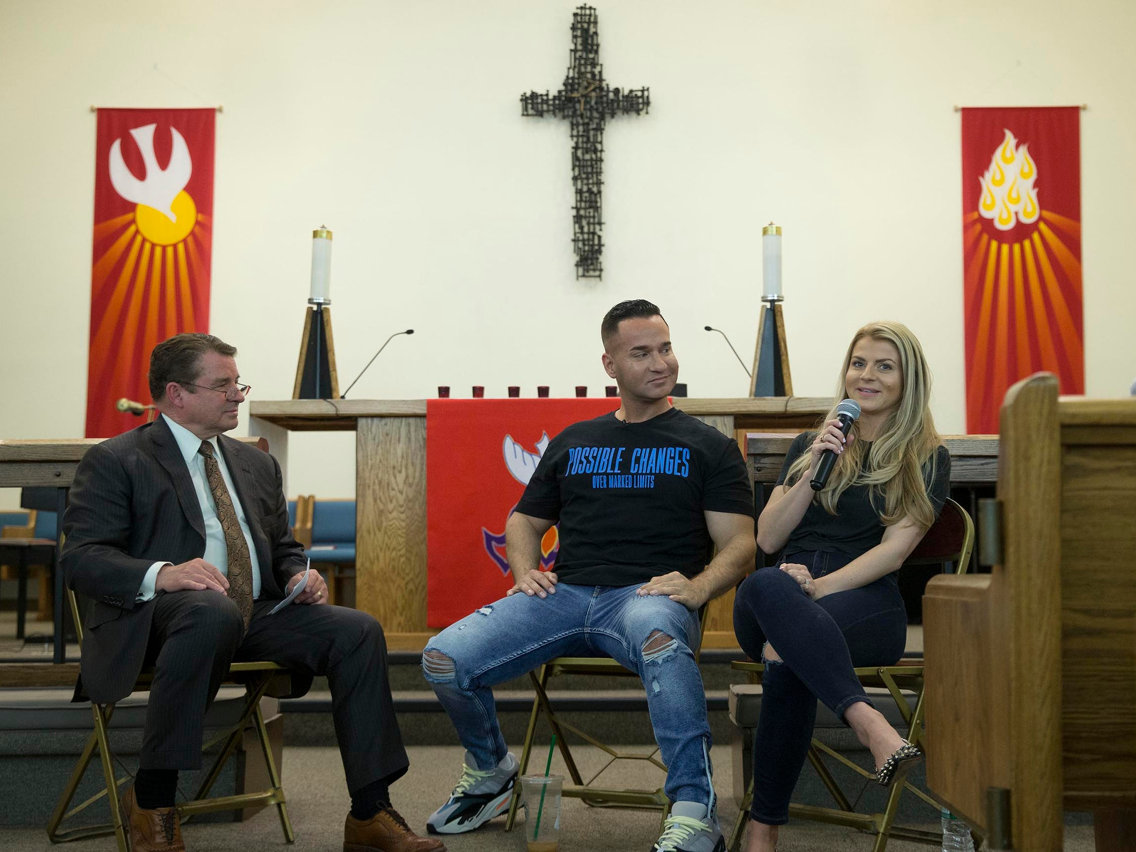 "Mike, center, with his fiancé Lauren Pesce, right, and Stephen Willis, co-founder of Hope Sheds Light. Mike ""The Situation"" Sorrentino  speaks about his evolution from poster boy for bad boy behavior as a cast member of Jersey Shore to a recovering addict and mature, sober cast member of the popular Jersey Shore Family Vacation. He is speaking at a meeting for Hope Sheds Light, a recovery group meeting at the Holy Cross Lutheran Church.  Toms River, NJ on Tuesday, May 22, 2018"