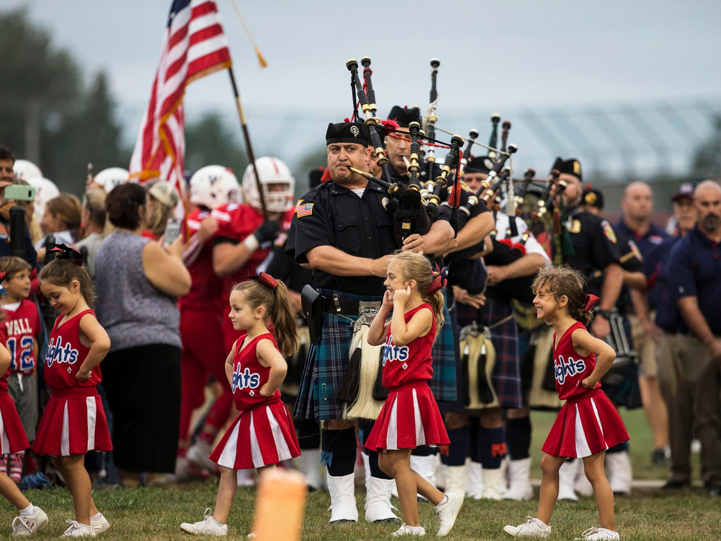 Lakewood vs Wall Township football. Prior to the game, a new scoreboard and bleachers were unveiled. Wall Township PBA 234, Wall Township Police Department, and Lakewood  Police Department held a dedication ceremony.  Wall Township, NJ on Friday, September 7, 2018