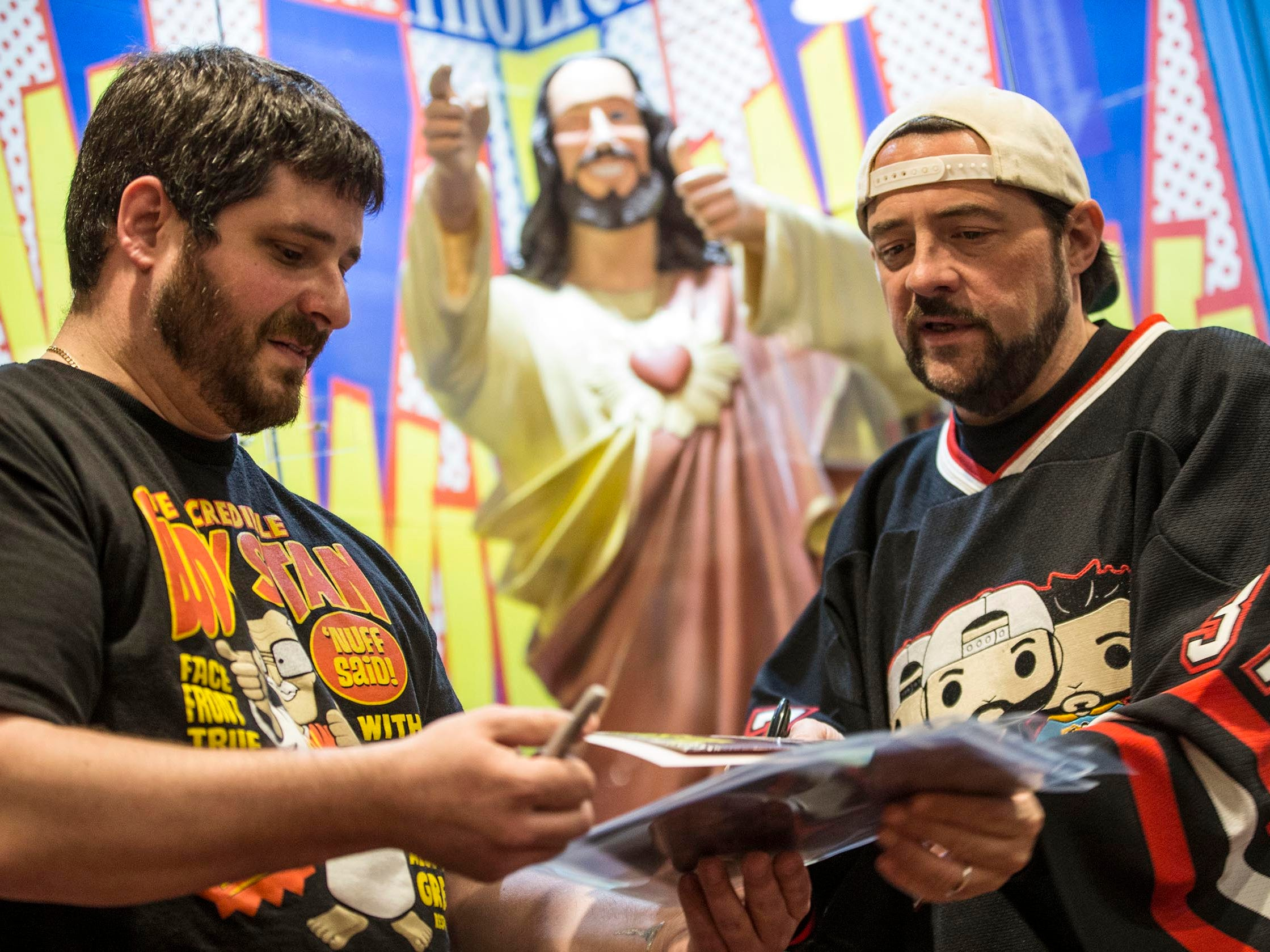 New Jersey native, filmmaker, Kevin Smith signs autographs for fans at his comic book store Jay and Silent Bob's Secret Stash. Jeff Lucarelli of Harrisburg, PA gets merchandise signed by Smith.  Red Bank, NJ on Saturday, May 5, 2018