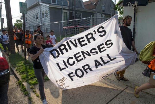 Cosecha, a grassroots advocacy group of  immigrants, welcomes walkers to Red Bank. The activists are participating in a 300 mile walk to show support for legislation that would offer driver's licenses to unauthorized immigrants, among others. Red Bank, NJ. on Thursday, June 7, 2018