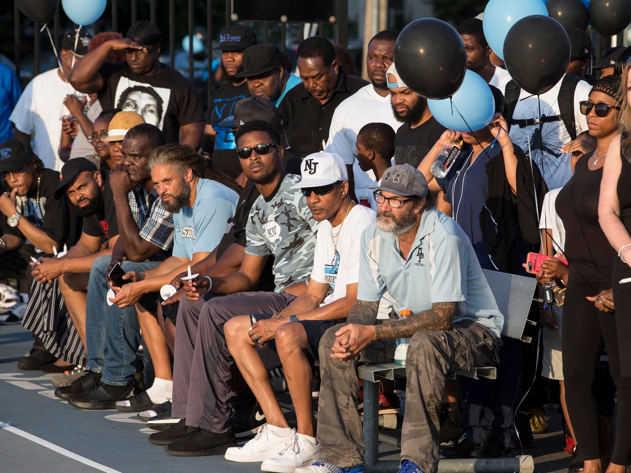Members of the Asbury Park community come together at the Donald Hammary Basketball Courts to remember the life of James Famularo who lost his life in a fire this past week.  Asbury Park, NJ on Thursday, July 12, 2018