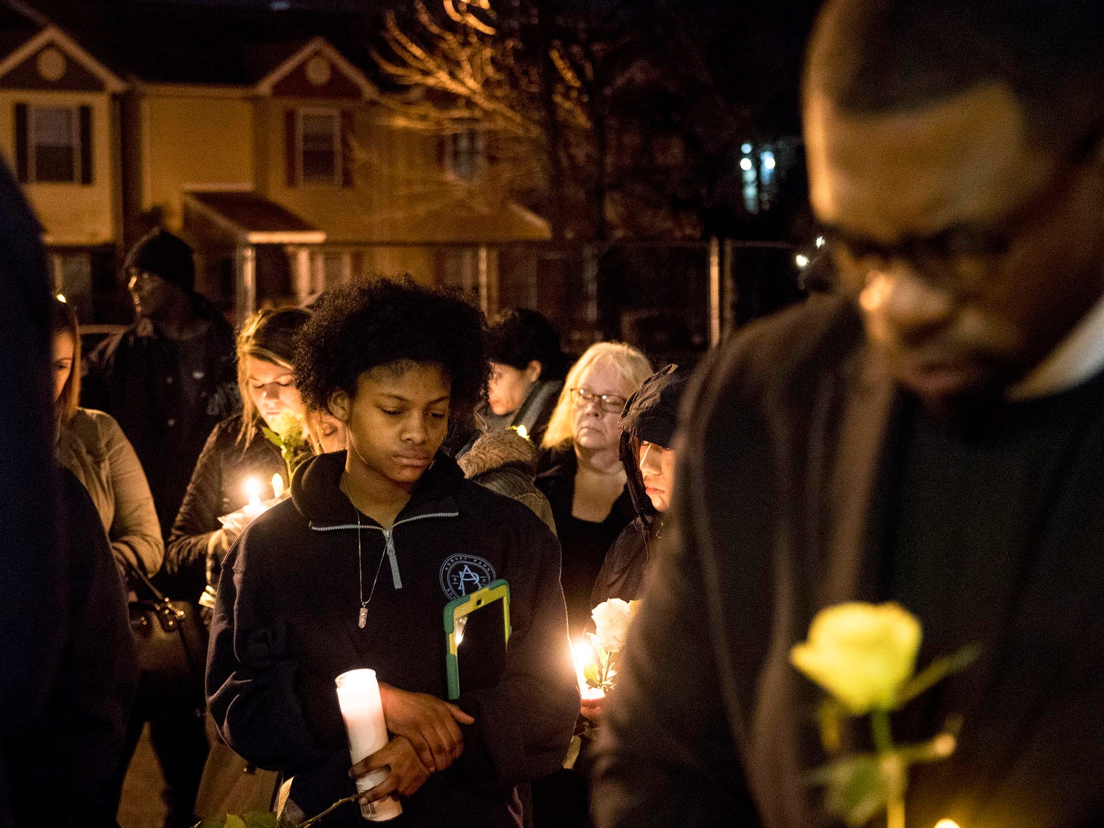Mourners gather at the Boys & Girls Clubs of Monmouth County to hold a vigil for the 10 year old boy who was shot and killed this past week. Asbury Park, NJ onSaturday, February 24, 2018