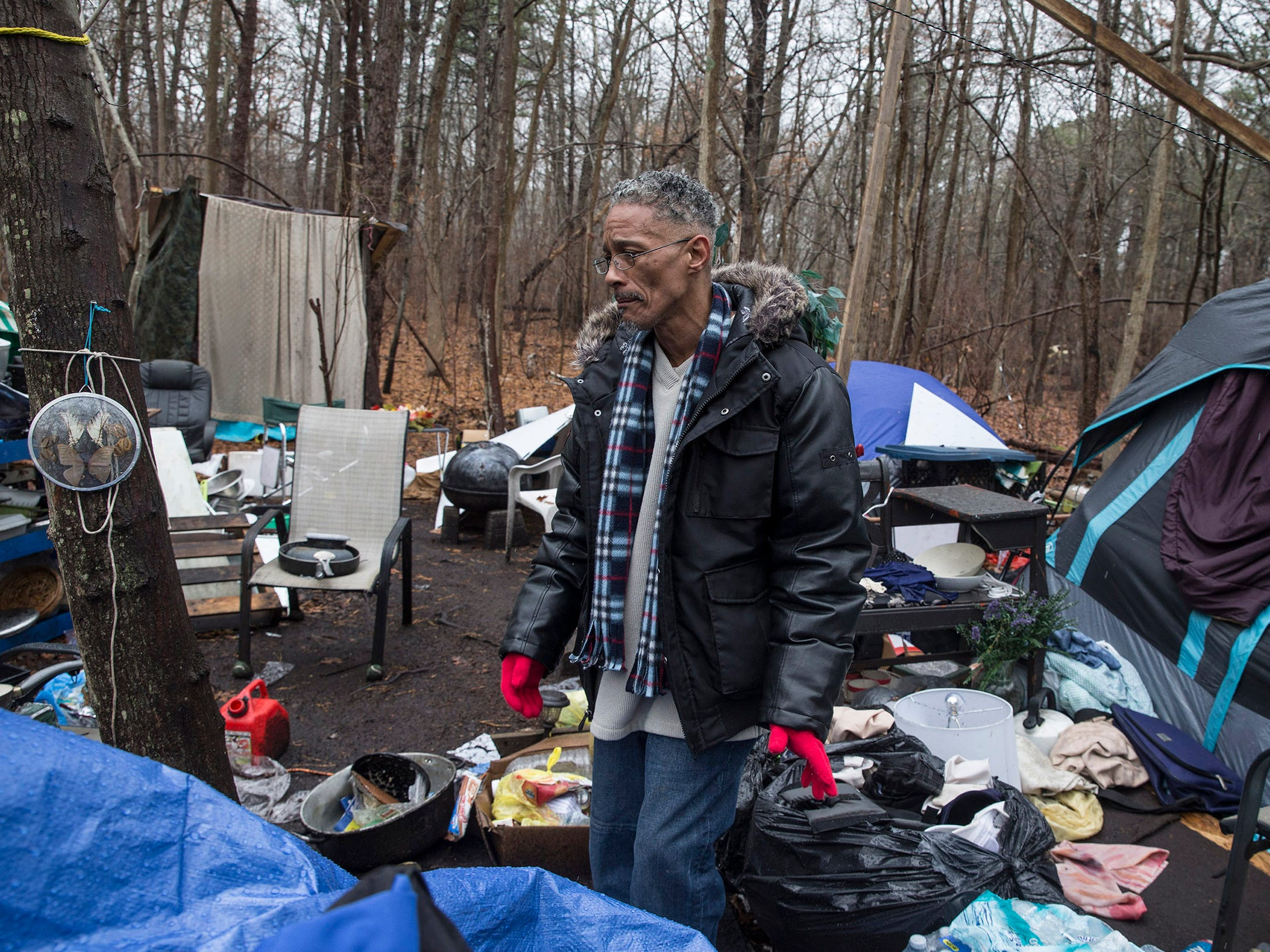 Carlos Santiago returns to the camp to start cleaning up in preparation for the groups return. About one dozen homeless people who live in a small encampment in the woods have been staying at the Crystal Inn since severe cold weather and snow hit the area. Donations collected made the hotel stay possible. Neptune, NJ on Wednesday, January 17, 2018