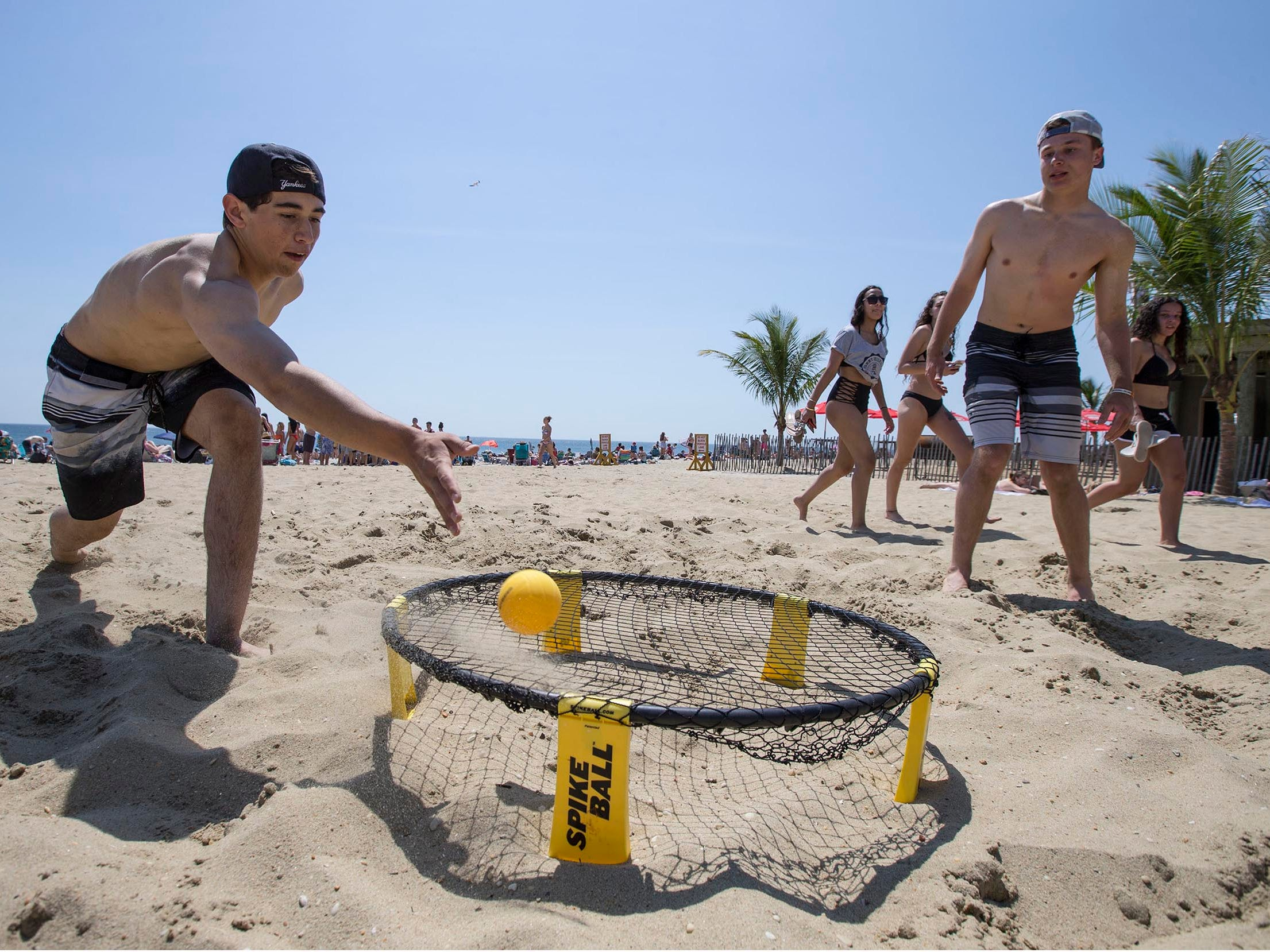 Tom Faggioni and Garrett Smith, both of Old Bridge, play spike ball. People flock to the beach in Long Branch to enjoy the beautiful weather as Memorial Day weekend gets underway. Long Branch, NJ on Friday, May 25, 2018