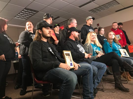 Family and friends gather at the Norwalk public library Nov. 30, 2018 to remember Joel Davis. His brother, Jesse, and sister, Aimee, are seated in the first row and flank his parents, Randy and Tanya.