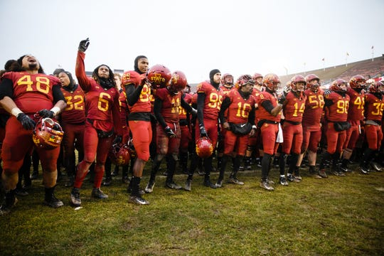 Iowa State players cheer after ISU defeated Drake 27-24 during their football game at Jack Trice Stadium on Saturday, Dec. 1, 2018, in Ames.