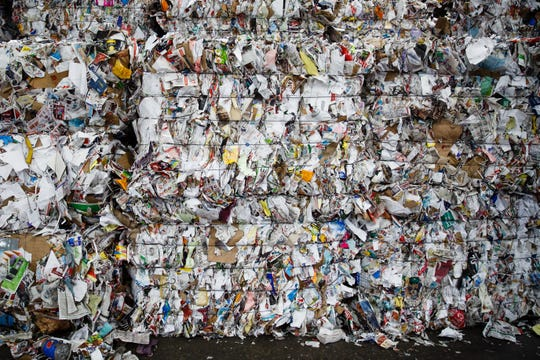 "Bound recycled paper sits waiting to be shipped out at the Mid America Recycling facility on Thursday, Nov. 29, 2018, in Des Moines. President Michael ""Mick"" Barry said the next big challenge for his industry is moving these large bundles as there is a shortage of truck drivers to help ship them."
