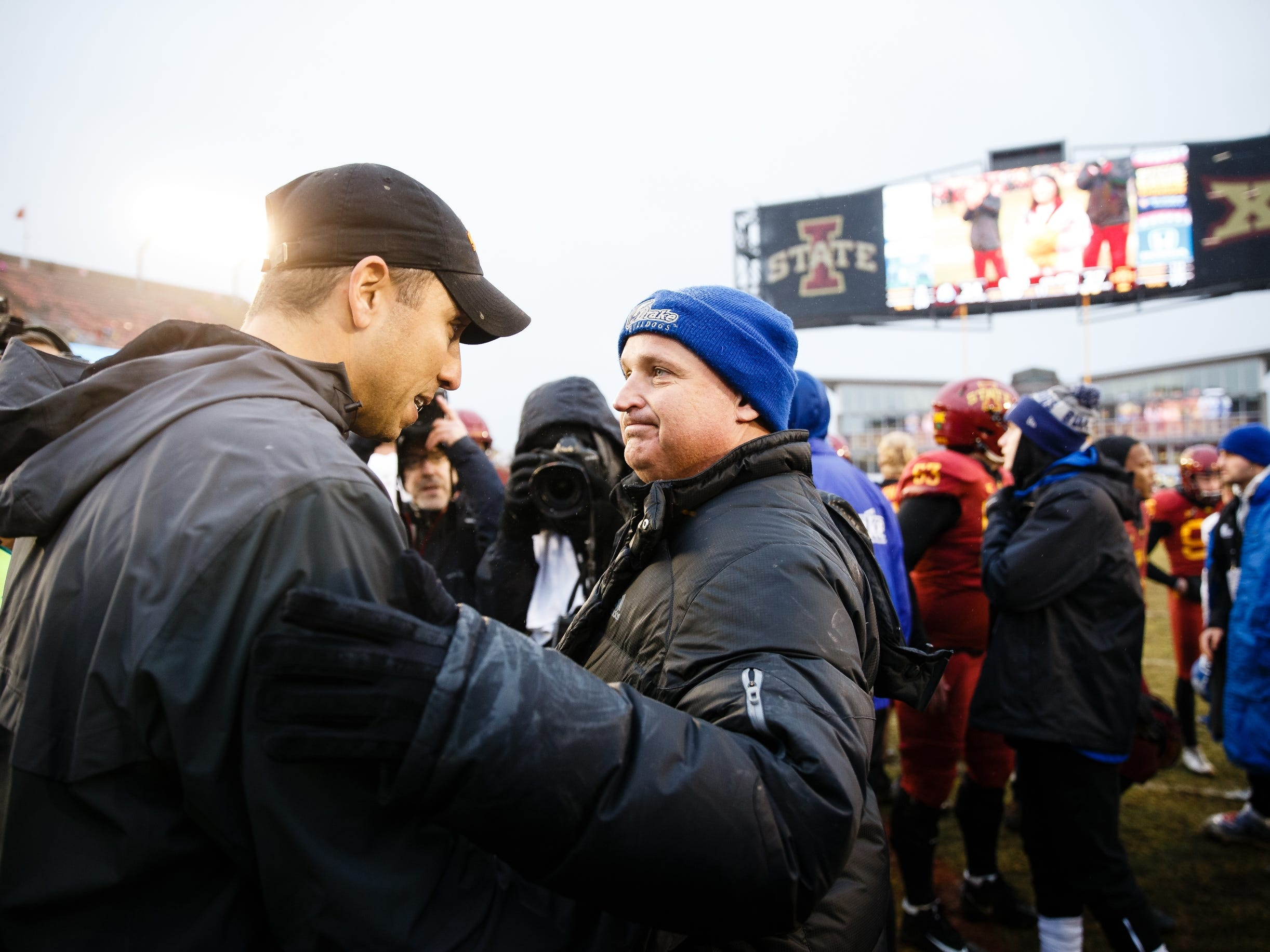 Iowa State head coach Matt Campbell, left, and Drake head coach Rick Fox talk at midfield after ISU defeated Drake 27-24 during their football game at Jack Trice Stadium on Saturday, Dec. 1, 2018, in Ames.
