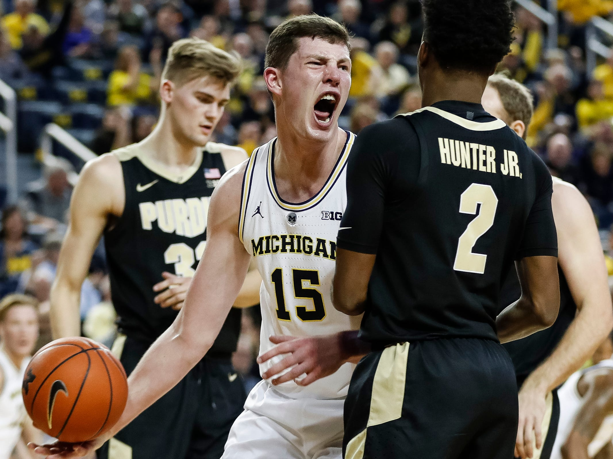 Michigan center Jon Teske (15) celebrates a dunk during the first half against Purdue at Crisler Center on Saturday, Dec. 1, 2018.