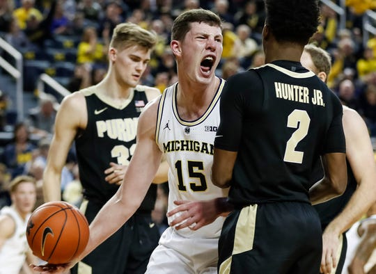 Michigan center Jon Teske (15) celebrates a dunk during the first half against Purdue at Crisler Center on Saturday, Dec. 1, 2018.