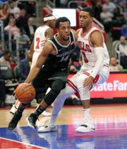 Detroit Pistons guard Ish Smith against Chicago Bulls guard Shaquille Harrison during the third quarter Friday, Nov. 30, 2018 at Little Caesars Arena in Detroit.