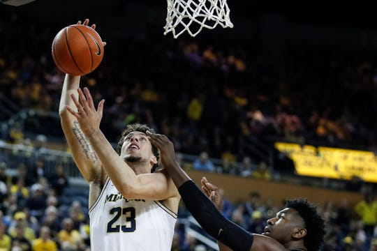 Michigan forward Brandon Johns Jr. makes a layup against Purdue during the second half at Crisler Center in Ann Arbor, Saturday, Dec. 1, 2018.