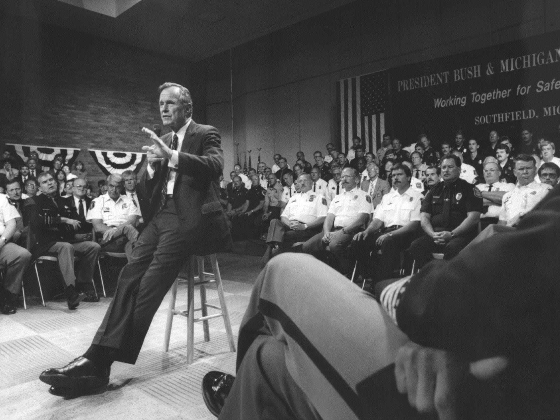 "President George Bush addresses police officials in June 1992 at the Southfield Civic Center. ""You deserve to get backed up,"" he told them."