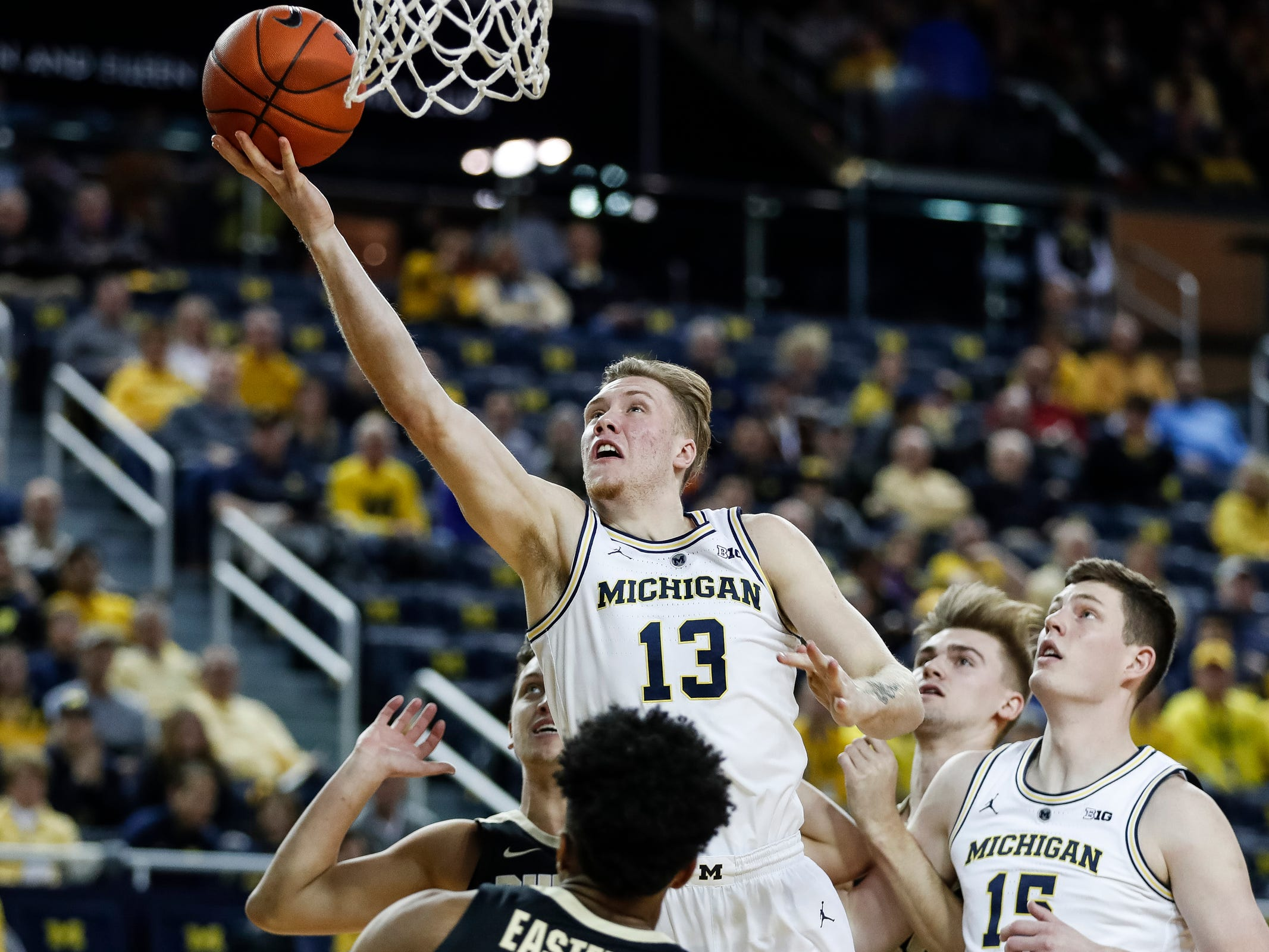 Michigan forward Ignas Brazdeikis (13) makes a layup during the first half against Purdue at Crisler Center on Saturday, Dec. 1, 2018.