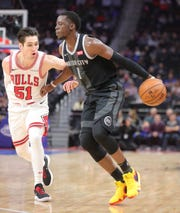 Detroit Pistons guard Reggie Jackson drives against Chicago Bulls guard Ryan Arcidiacono during the fourth quarter Friday, Nov. 30, 2018 at Little Caesars Arena in Detroit.