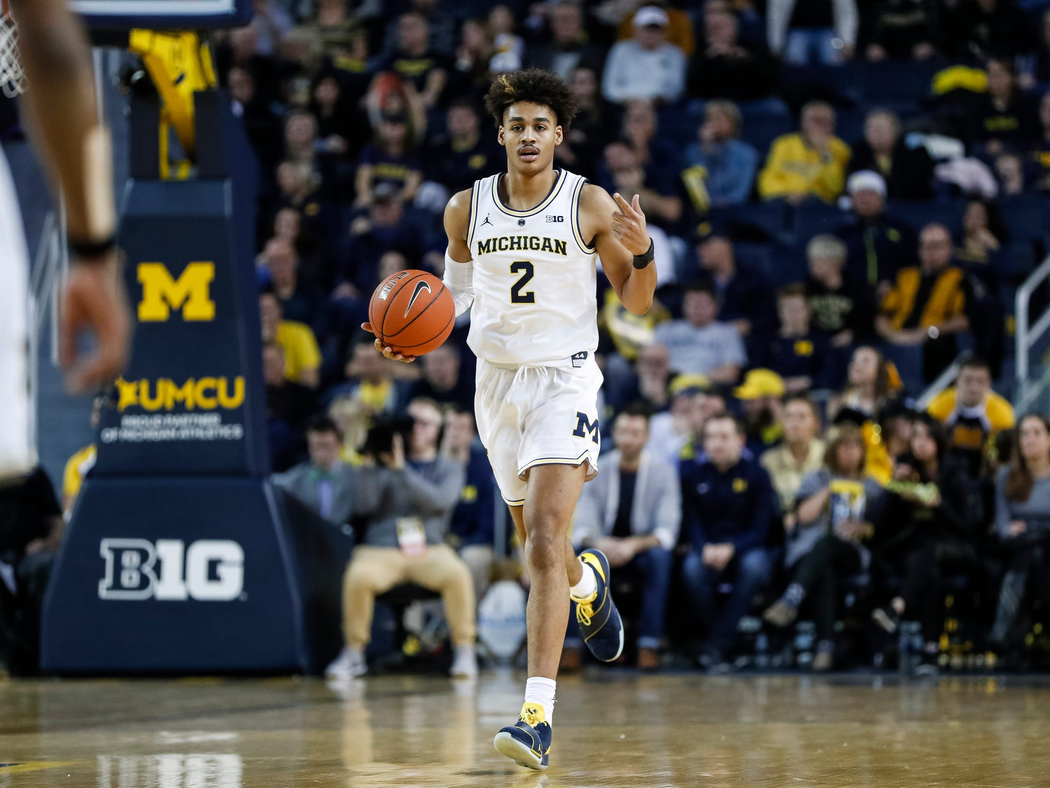 Michigan guard Jordan Poole (2) dribbles during the first half against Purdue at Crisler Center on Saturday, Dec. 1, 2018.