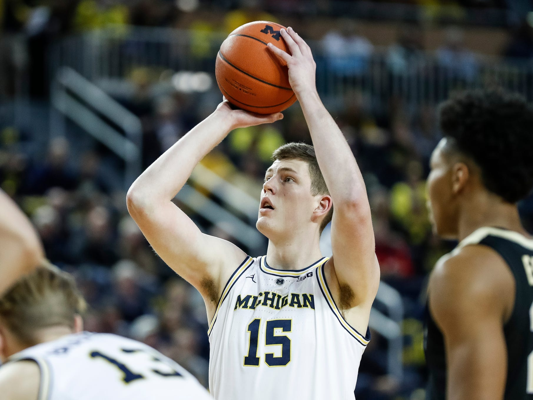 Michigan center Jon Teske attempts for a free thrown during the first half against Purdue at Crisler Center on Saturday, Dec. 1, 2018.