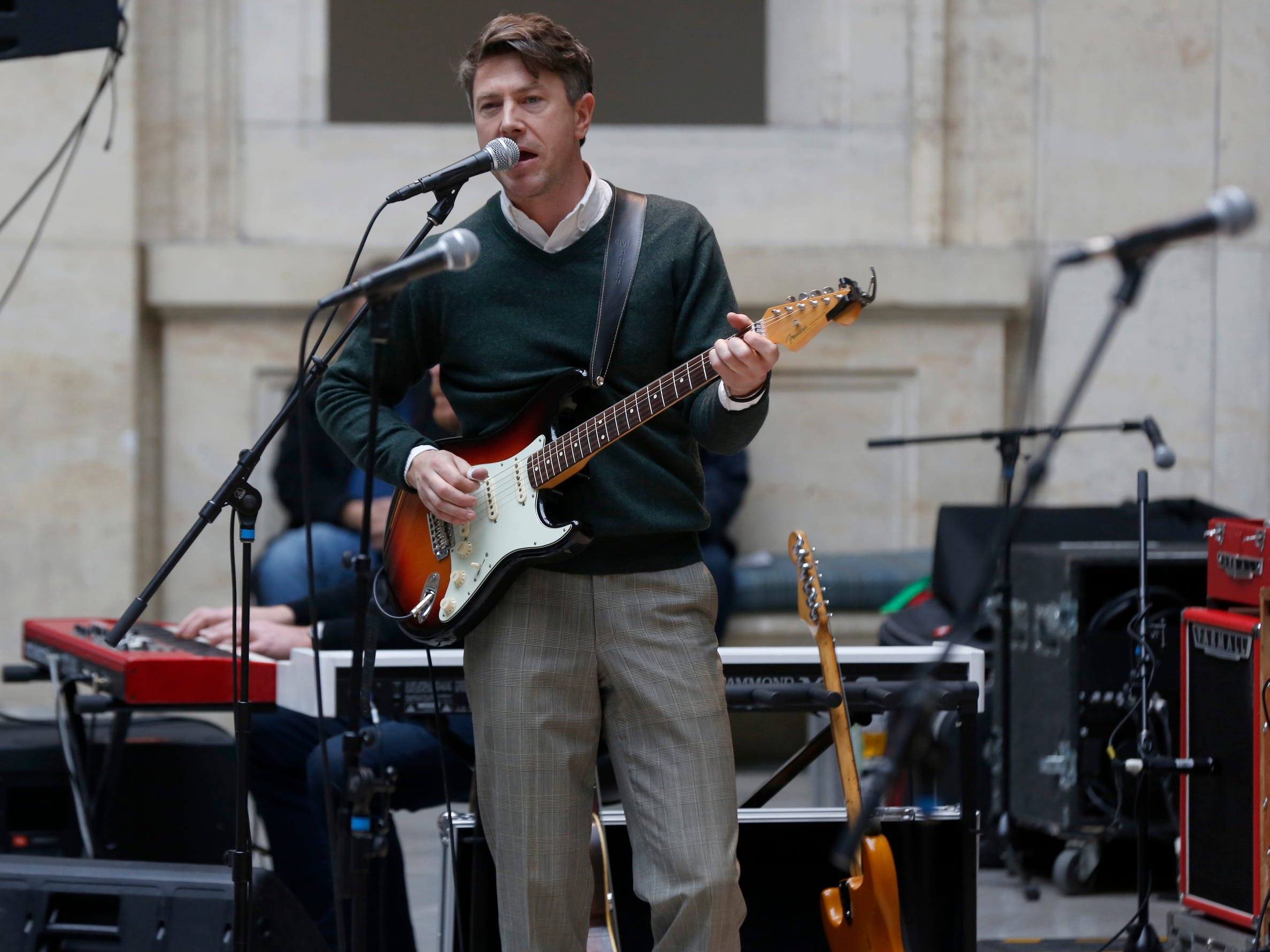 Luke Winslow-King and his band perform in the Rivera Court at the Detroit Institute of Arts in Detroit on Saturday, December 1, 2018 during the daytime session of Noel Night.