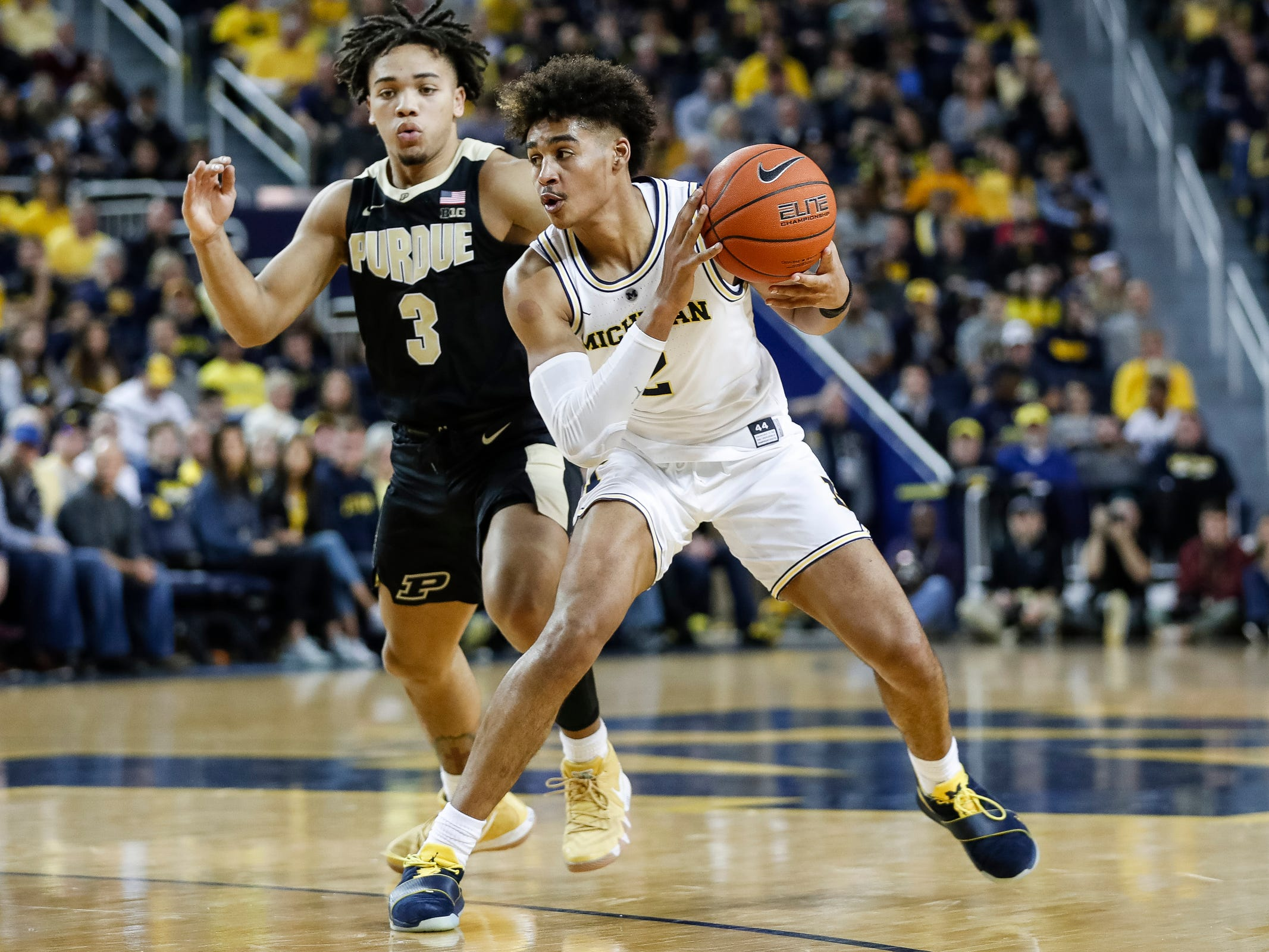 Michigan guard Jordan Poole dribbles past Purdue guard Carsen Edwards during the first half at Crisler Center on Saturday, Dec. 1, 2018.