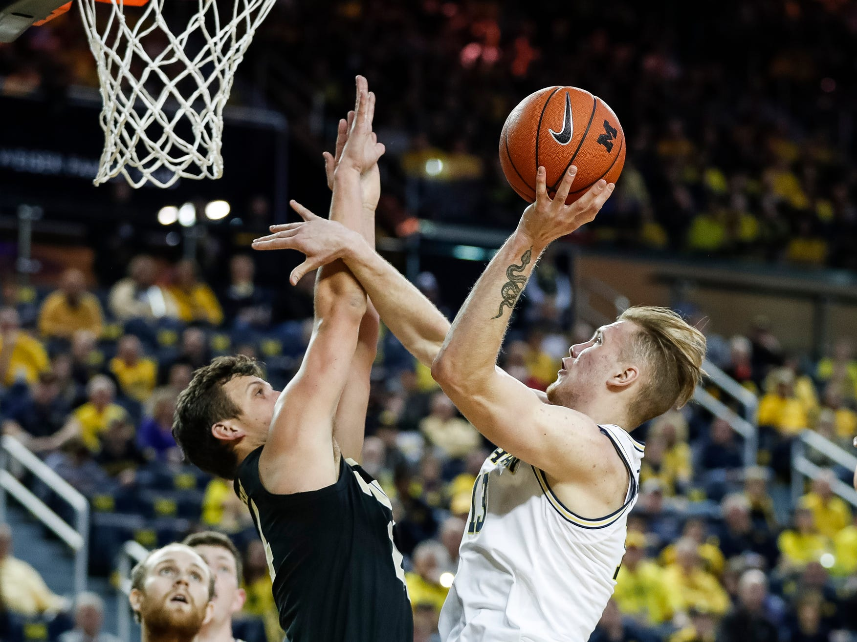 Michigan forward Ignas Brazdeikis (13) goes for the basket against Purdue forward Grady Eifert (24) during the first half at Crisler Center on Saturday, Dec. 1, 2018.