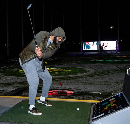 Detroit Pistons center Andre Drummond takes a swing at the new Topgolf in Auburn Hills on Wednesday, Nov. 28, 2018.