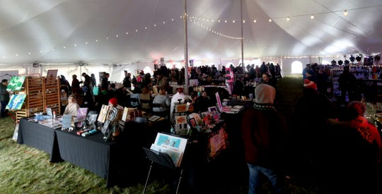 The holiday marketplace tent had items for sale during the Noel Night at the Detroit Institute of Arts in Detroit on Saturday, December 1, 2018.
